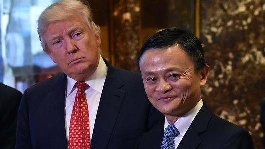 Jack Ma (R), founder and executive chairman of Alibaba Group, and at the time President-elect Donald Trump pose for the media after their meeting at Trump Tower on January 9, 2017.