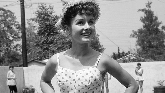 Debbie Reynolds entertains guest at her pool party in Los Angeles, circa 1955.