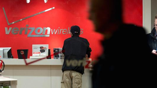 A customer stands at a counter inside a Verizon Wireless retail store in Washington, D.C.