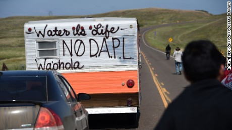 Protestors march to a construction site for the Dakota Access Pipeline.