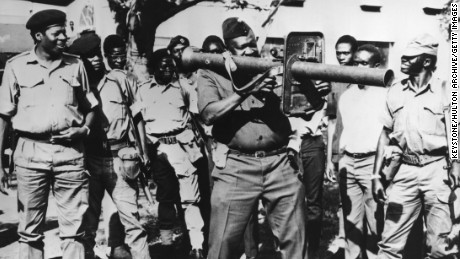 Idi Amin firing a rocket launcher with troops still loyal to him in April 1979.