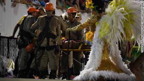 Firefighters assist after a collapse on a float during Rio's Carnival at the Sambadrome on February 28, 2017.