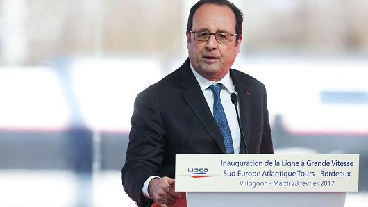 French President Francois Hollande delivers a speech as he attends the inauguration of the new 'Sud Europe Atlantique' (South Europe Atlantic) high-speed rail line, linking Tours and Bordeaux, on February 28, 2017, in Villognon, central France.