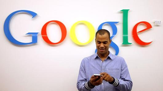 A visitor uses a cell phone in the Google offices in Berlin, Germany.