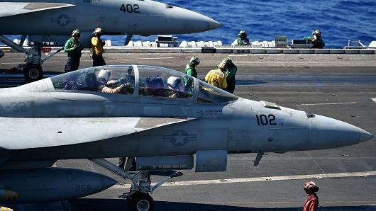 An F/A-18E and An F/A-18F (front) Super Hornet stand ready on the US navy's super carrier USS Dwight D. Eisenhower (CVN-69) ('Ike') in the Mediterranean Sea on July 7, 2016.