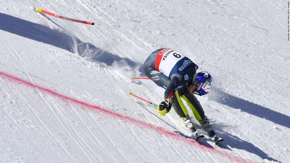 France's Alexis Pinturault throws himself over the finish line in St. Moritz.