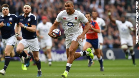 England's centre Jonathan Joseph runs to score his team's first try during the Six Nations international rugby union match between England and Scotland
