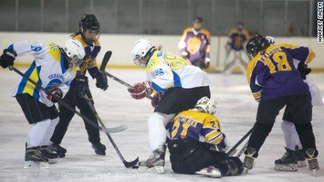 Dnipro Queens and Kyiv Ukrainochka players wrestle for possession during the final.
