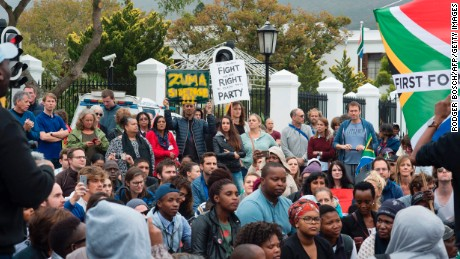 Hundreds outside Parliament in Cape Town protest Gordhan's dismissal on Friday.