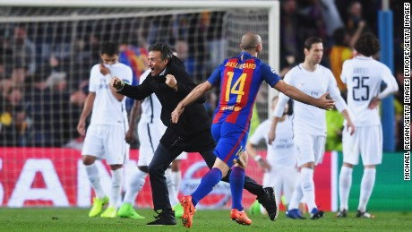 PSG players look dejected as Barca's coach Luis Enrique celebrates with Javier Mascherano.