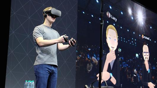 Facebook co-founder and chief executive, Mark Zuckerberg, speaks at an Oculus developers conference while wearing a virtual reality headset in San Jose, California
