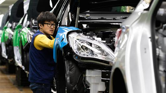 An employee assembles a Hyundai Motor vehicle on the production line at the company's factory in Asan, South Korea.