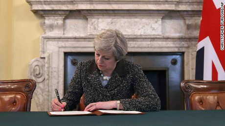 Theresa May signs the official letter triggering Brexit.