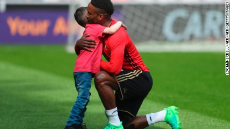 Defoe hugs Lowery ahead of Sunderland's game against Manchester United in April.
