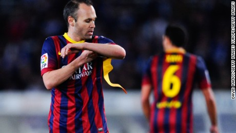 Andres Iniesta receives the Barcelona captain's armband from the departing Xavi Hernandez.