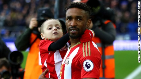 Lowery is carried out by Defoe prior to Sunderland's match against Everton at Goodison Park in Feburary.
