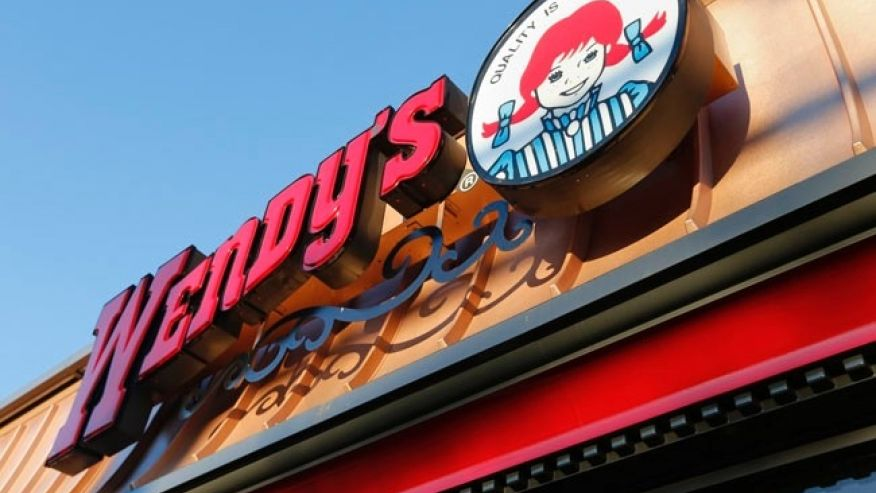 FILE - This Friday, March 21, 2014, file photo, shows a Wendy's restaurant in Providence, R.I. A Nevada teen's joke Twitter campaign to win a year of free chicken nuggets from Wendy's may become the platform's most retweeted post of all time. Carter Wilkinson launched the effort on April 5, 2017. (AP Photo/Michael Dwyer, File)