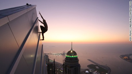 Urban climber Oleg Cricket in action in Dubai, December 2015. Not all urban climbing activity in the city is legal, but Dubai's many skyscrapers have proved  tempting for practitioners.