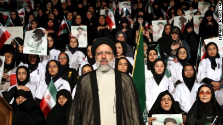 Ebrahim Raisi stands among his supporters during an April campaign rally in Tehran.