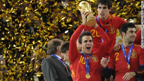 Cesc Fabregas, one of La Masia's graduates, holds aloft the World Cup trophy after Spain won the 2010 final