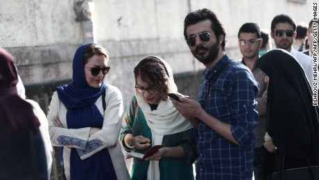 Iranians queue to cast their ballots in presidential elections in Tehran on May 19, 2017.