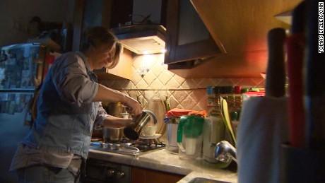 Novitskaya cooking in her Moscow apartment.