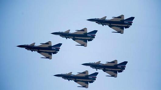 People's Liberation Army Air Force (PLAAF) Chengdu J-10 fighter jets, manufactured by Chengdu Aerospace Corp., a unit of Aviation Industry Corp. of China (AVIC), fly during an aerobatics display during the China International Aviation & Aerospace Exhibition in Zhuhai, Guangdong province, China