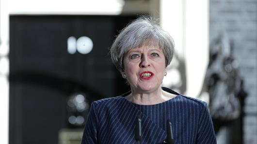 British Prime Minister Theresa May speaks to the media outside 10 Downing Street in central London on April 18, 2017. British Prime Minister Theresa May called today for an early general election on June 8 in a surprise announcement as Britain prepares for delicate negotiations on leaving the European Union.