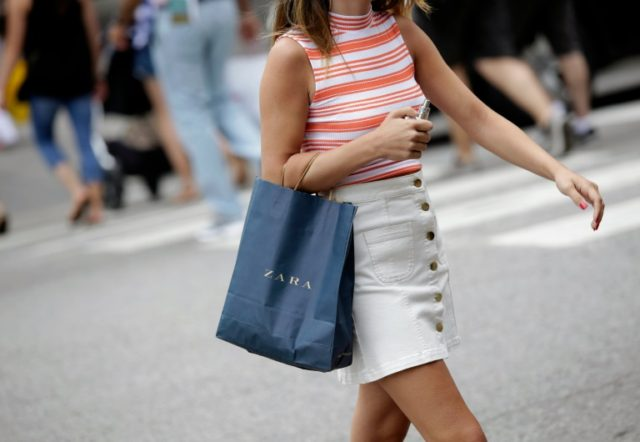 US consumers in June continued to spend faster than they earned while inflation slowed