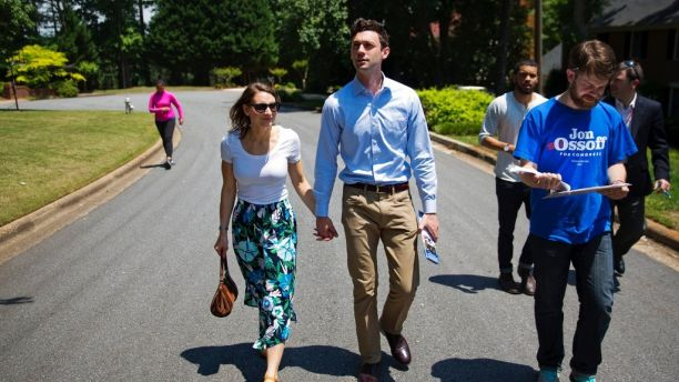 Jon Ossoff, center, a 30-year-old Democrat running for Congress in Georgia's traditionally conservative 6th Congressional District, and fiancee Alisha Kramer, left, walk with organizer Eliot Beckham, right, while campaigning in Sandy Springs, Ga., Thursday, May 11, 2017. Ossoff's fortunes in a June 20 matchup with Republican Karen Handel will be an early test of how the Republicans' vote to gut the Affordable Care Act and President Donald Trump's decision to fire the FBI director are playing with voters. Both parties see the Georgia race as an indicator for the 2018 midterm elections. (AP Photo/David Goldman)