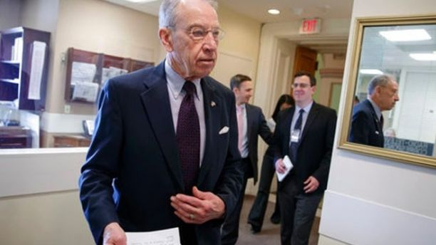 Senate Judiciary Committee Chairman Chuck Grassley, R-Iowa, arrives for a news conference just after the confirmation vote for President Donald Trump's high court nominee, Neil Gorsuch, on Capitol Hill in Washington, Friday, April 7, 2017. (AP Photo/J. Scott Applewhite)