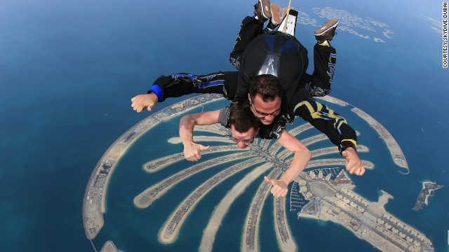 A tandem skydive gives you sweeping views over the city and desert as you plummet almost 4,000 meters (13,000 feet) toward the beach next to the Palm Jumeirah.