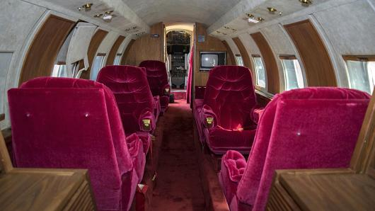 This undated file photo provided by GWS Auctions, Inc. shows the interior of a private jet once owned by Elvis Presley on a runway in New Mexico. The plane has been auctioned after sitting on a runway in New Mexico for 35 years. The plane sold for $430,000 on Saturday, May 27, 2017, at an Agoura Hills, Calif., event featuring celebrity memorabilia, GWS Auctions Inc. said.