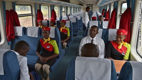 Hospitality crew members inside a new passenger train.