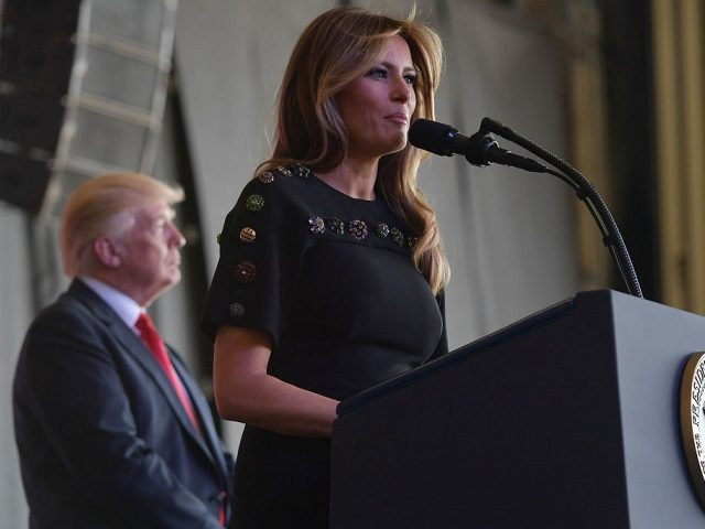 US First Lady Melania Trump address US military personnel and families at Naval Air Station Sigonella as US President Donald Trump stands on stage, after G7 summit of Heads of State and Government, on May 27, 2017 near Taormina in Sicily. / AFP PHOTO / MANDEL NGAN (Photo credit should read MANDEL NGAN/AFP/Getty Images)