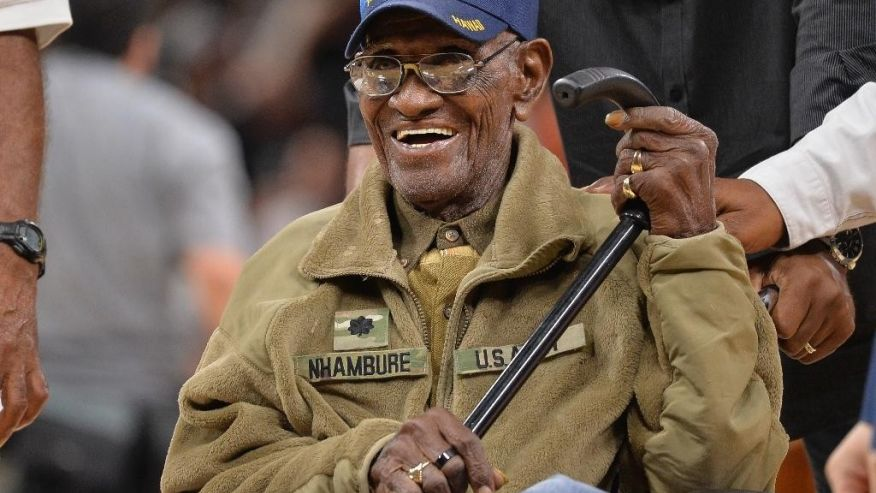 FILE - In this March 23, 2017, file photo, Richard Overton leaves the court after a special presentation honoring him as the oldest living American war veteran, during a timeout in an NBA basketball game between the Memphis Grizzlies and the San Antonio Spurs. Overton was honored by his hometown of Austin, Texas, on his 111th birthday on May 11, 2017. (AP Photo/Darren Abate, File)