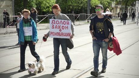 A dog joins Sunday's demonstration.