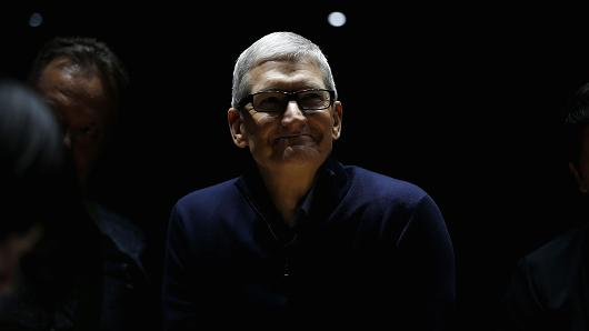 Apple CEO Tim Cook smiles during a product launch event on October 27, 2016 in Cupertino, California. Apple Inc. unveiled the latest iterations of its MacBook Pro line of laptops and TV app.