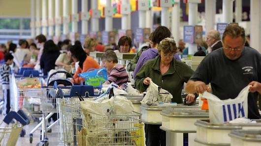 Shoppers queue to pay for their shopping in the Tesco Extra superstore on April 20, 2009 in New Malden, Surrey, England.