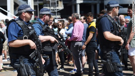 Armed police officers patrol outside a rugby final at Twickenham in London on Saturday.
