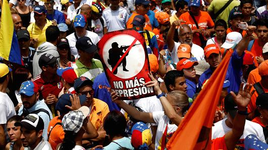 "People participate in an opposition rally in Caracas, Venezuela, April 8, 2017. The sign reads ""no more repression""."