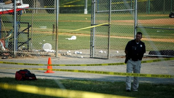 A police officer mans a shooting scene after a gunman opened fire on Republican members of Congress during a baseball practice near Washington in Alexandria, Virginia,  June 14, 2017. REUTERS/Joshua Roberts - RTS171V0