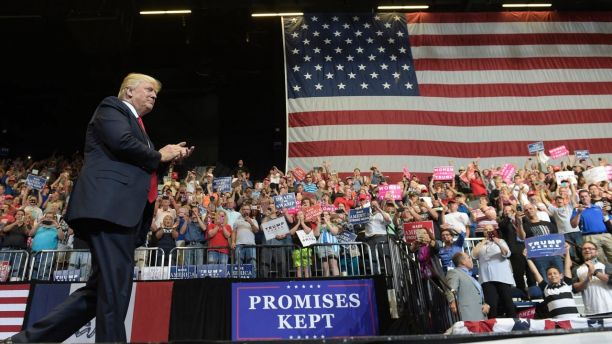 President Donald Trump arrives on stage to speak at the U.S. Cellular Center in Cedar Rapids, Iowa, Wednesday, June 21, 2017. This is Trump's first visit to Iowa since the election. (AP Photo/Susan Walsh)