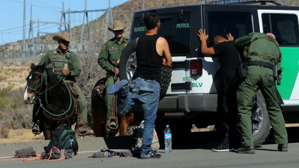 U.S. Border Patrol supervisor Bobby Stine frisks a man a few hundred meters from the U.S.-Mexico border fence near Jacumba, California, U.S., November 14, 2016. REUTERS/Mike Blake         SEARCH