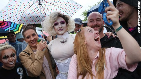 Supporters of gay rights gathered outside the Chancellery to celebrate Friday.