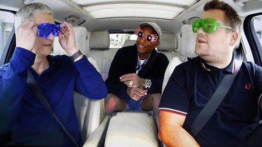 Apple Inc CEO Tim Cook is shown with TV personality James Corden and musician Pharrell during a taped comedy bit in this image shot from a projection screen during an Apple media event in San Francisco, California, U.S. September 7, 2016.