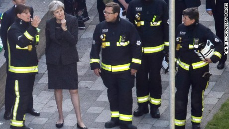 British Prime Minister Theresa May speaks to Dany Cotton, Commissioner of the London Fire Brigade at the scene.