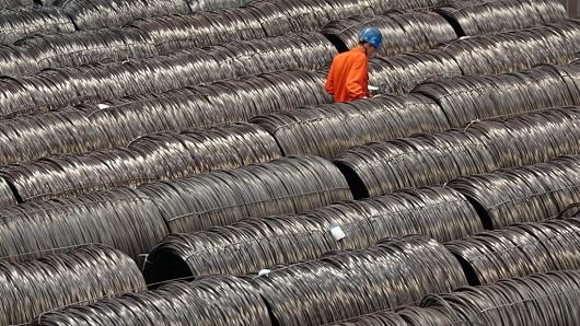 A worker checks the labels on the steel wire robs at the Dongbei Special Steel Group plant on May 15, 2017 in Dalian, Liaoning Province of China.