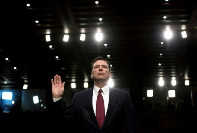 Ousted FBI director James Comey is sworn in during a hearing before the Senate Select Committee on Intelligence on June 8, 2017