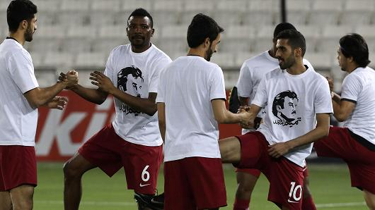 June 13, 2017: Football players of Qatar's national team wear t-shirts bearing portraits of Emir Sheikh Tamim bin Hamad Al-Thani in support of the Qatari leader amid the ongoing diplomatic crisis surrounding Doha and other Gulf countries.